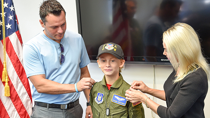 Ethan Hoffman, a 12-year-old from Howland, is sworn in as Pilot for a Day.