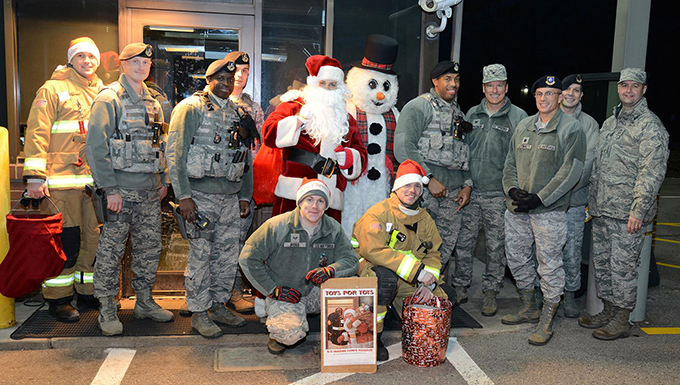 Airmen pose for a photo while collecting toys for the Marine Corps Reserve's Toys for Tots campaign.